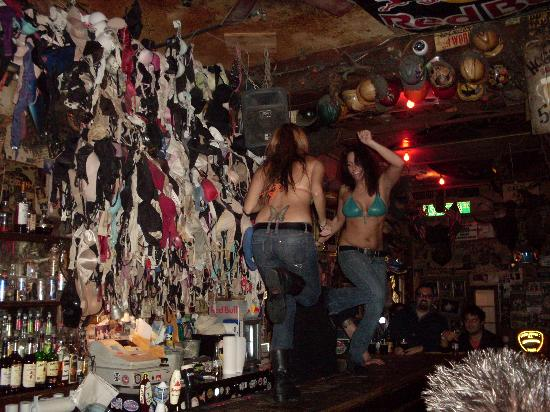 Now where are we going to see chicks dancing on bars backed by hundreds of musty old bras?